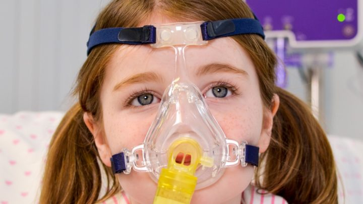 Photo of child with paediatric face mask